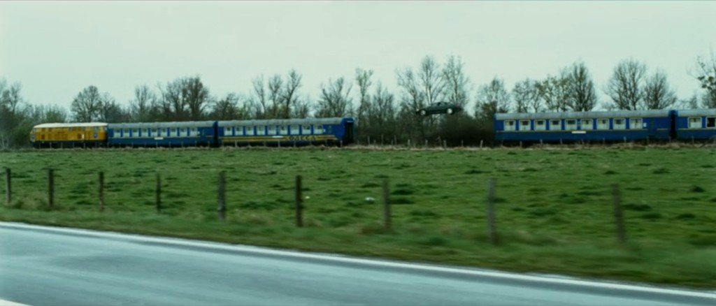 Still image capture from the film Transporter 3 of a 2008 Audi A8 L W12 jumping from train to train.