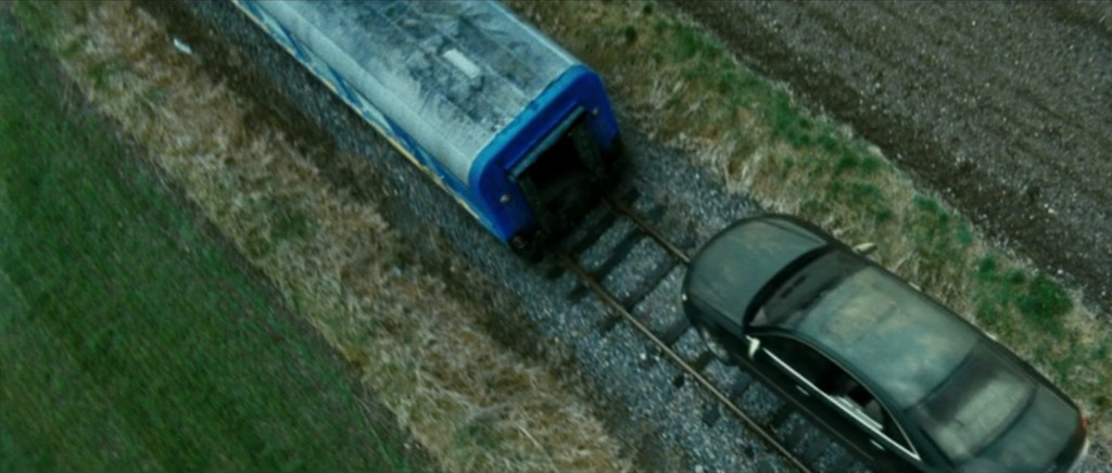 Still image capture from the film Transporter 3 of a 2008 Audi A8 L W12 jumping from train to train (top view).