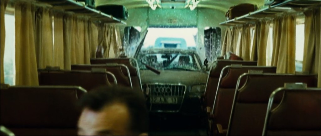 Still image capture from the film Transporter 3 of a 2008 Audi A8 L W12 crashing into the passenger car of a moving train.