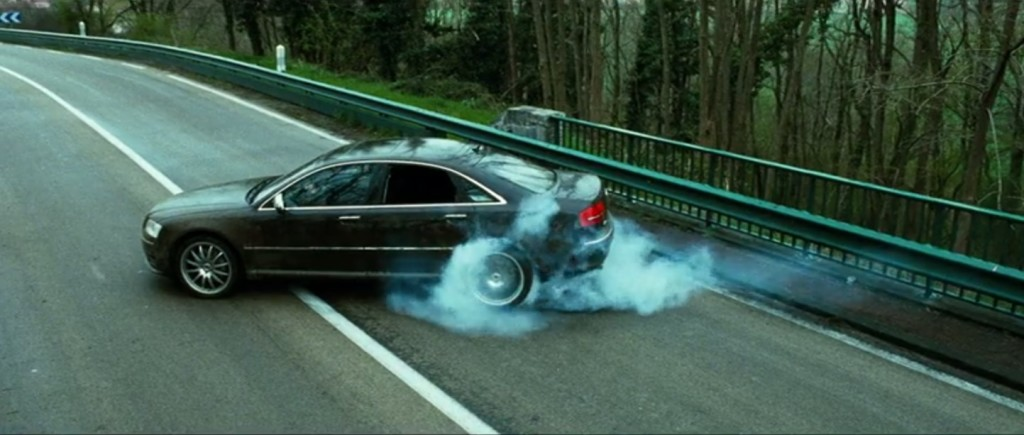 Still image capture from the film Transporter 3 of a 2008 Audi A8 L W12 spinning its rear wheels.
