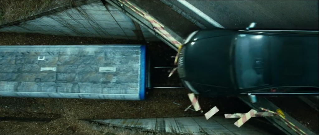 Still image capture from the film Transporter 3 of a 2008 Audi A8 L W12 jumping from bridge to train.