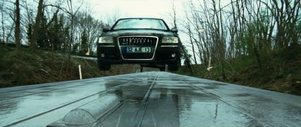 Still image capture from the film Transporter 3 of a 2008 Audi A8 L W12 landing on the roof of a train.