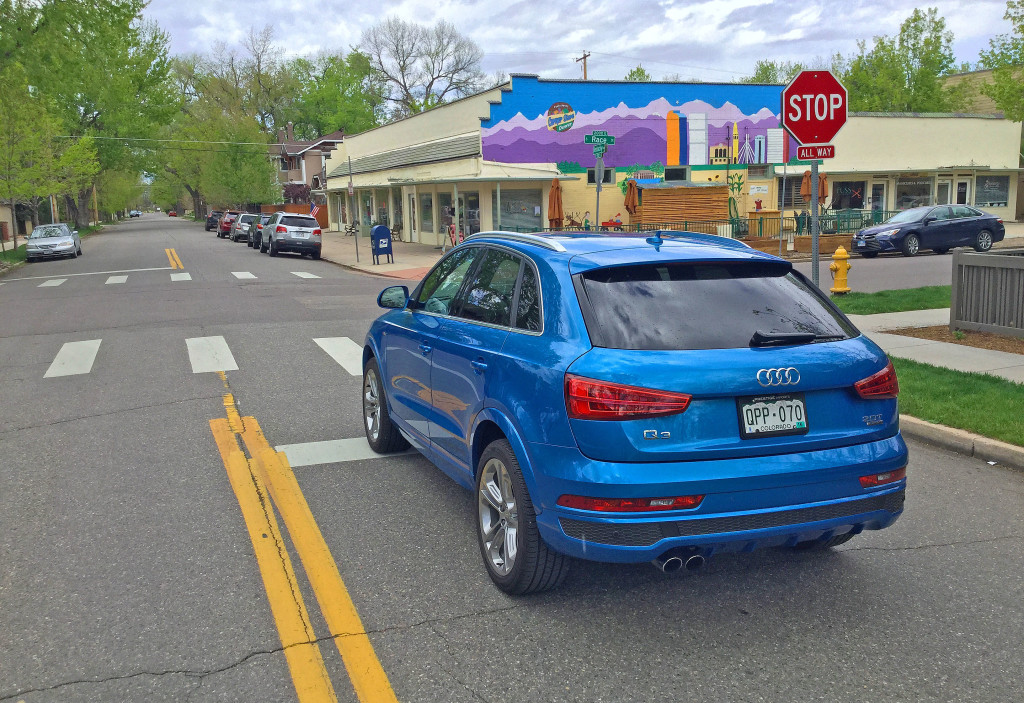 Audi Q3 in Hainan Blue metallic at the intersection of South Race St.and East Kentucky Ave. in Denver's Washington Park neighborhood.
