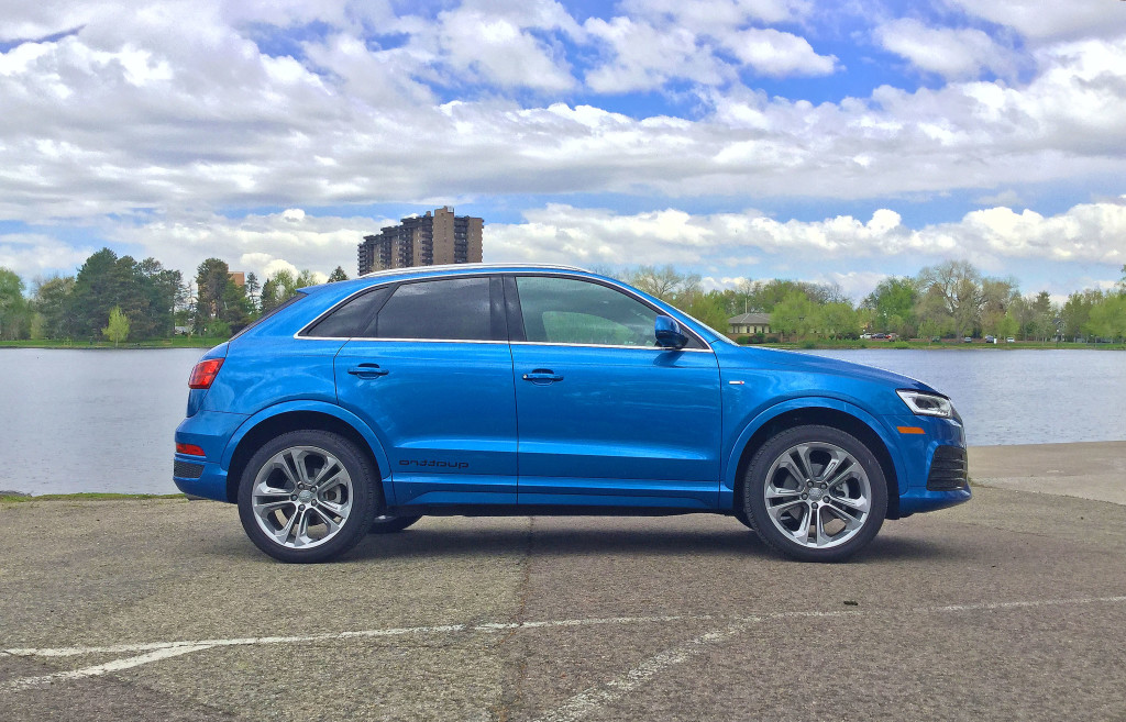 Audi Q3 in Hainan Blue metallic parked near a lake in Denver's Wash Park neighborhood.