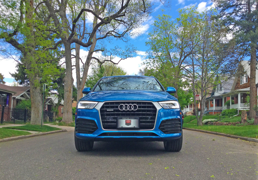 Audi Q3 in Hainan Blue metallic parked on a tree lined street in Denver's Wash Park neighborhood.