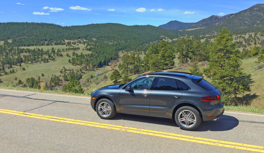2017 Porsche Macan S Review - The Porsche Macan viewed from the driver's side with a valley and mountains in the distance
