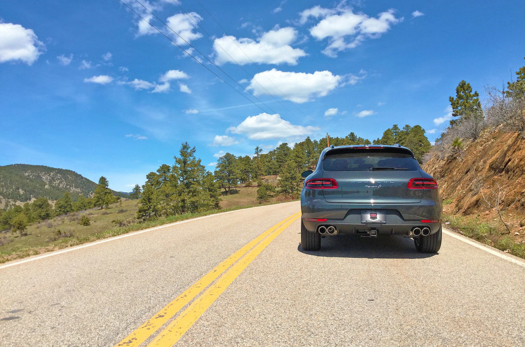 2017 Porsche Macan S Review - The Porsche Macan as viewed from the rear with mountains and blue Colorado skies in the background.