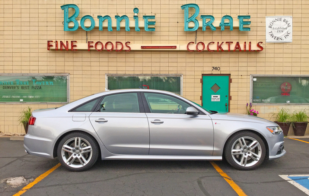 Side view of the 2016 Audi A6 in front of Bonnie Brae Tavern in Denver's Belcaro Neighborhood