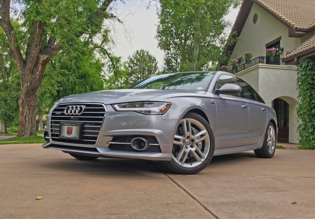 The 2016 Audi A6 parked in a driveway on South Garfield Street in the Belcaro Neighborhood, Denver.