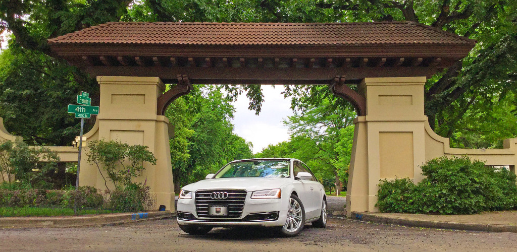 The 2016 Audi A8L parked underneath the Spanish-style arch at 4th and Franklin Street in the historic Denver Country Club Neighborhood