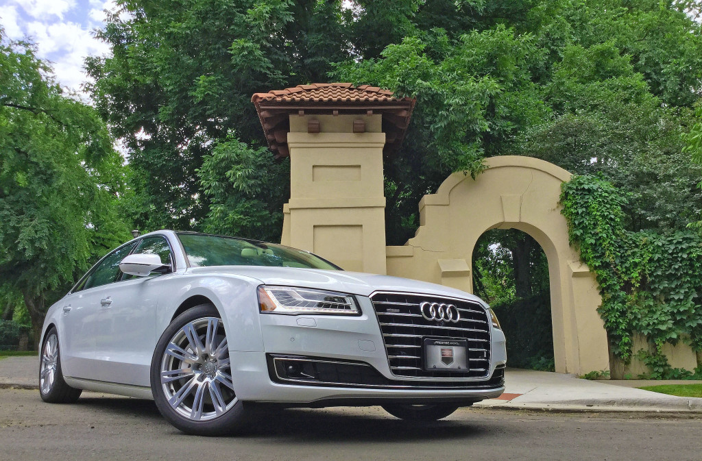 The 2016 Audi A8L parked beside a small, Spanish-style arch at 4th and Gilpin Street in the historic Denver Country Club neighborhood