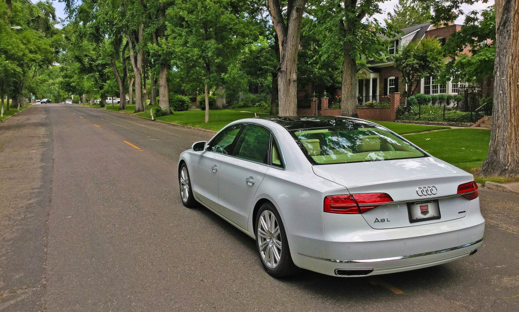 The rear view of the 2016 Audi A8L on Williams Street between 4th and 5th Avenues in the Country Club neighborhood of Denver, CO