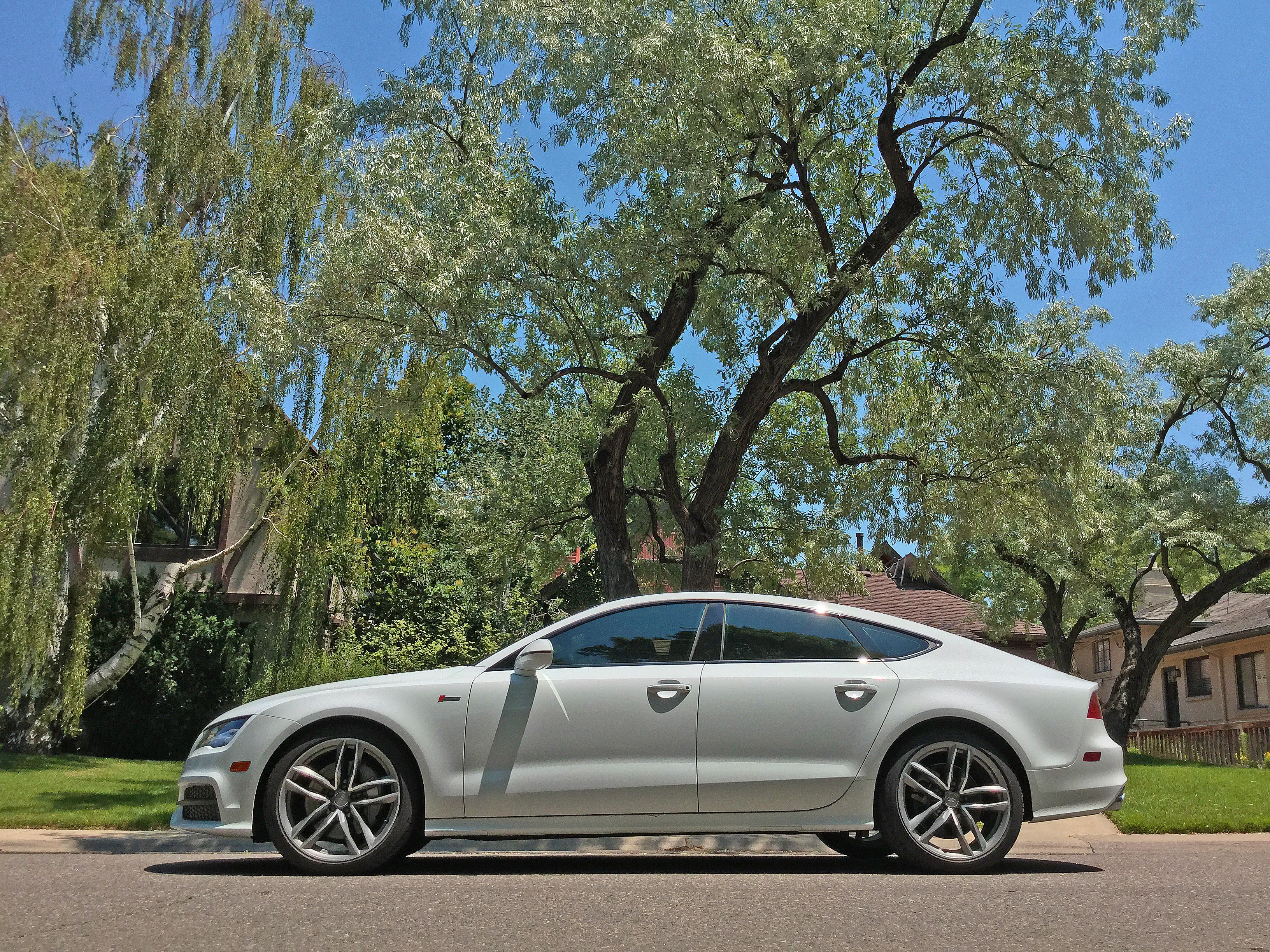 Side view of the 2016 Audi A7 on a quiet street in the Hilltop neighborhood of Denver, CO