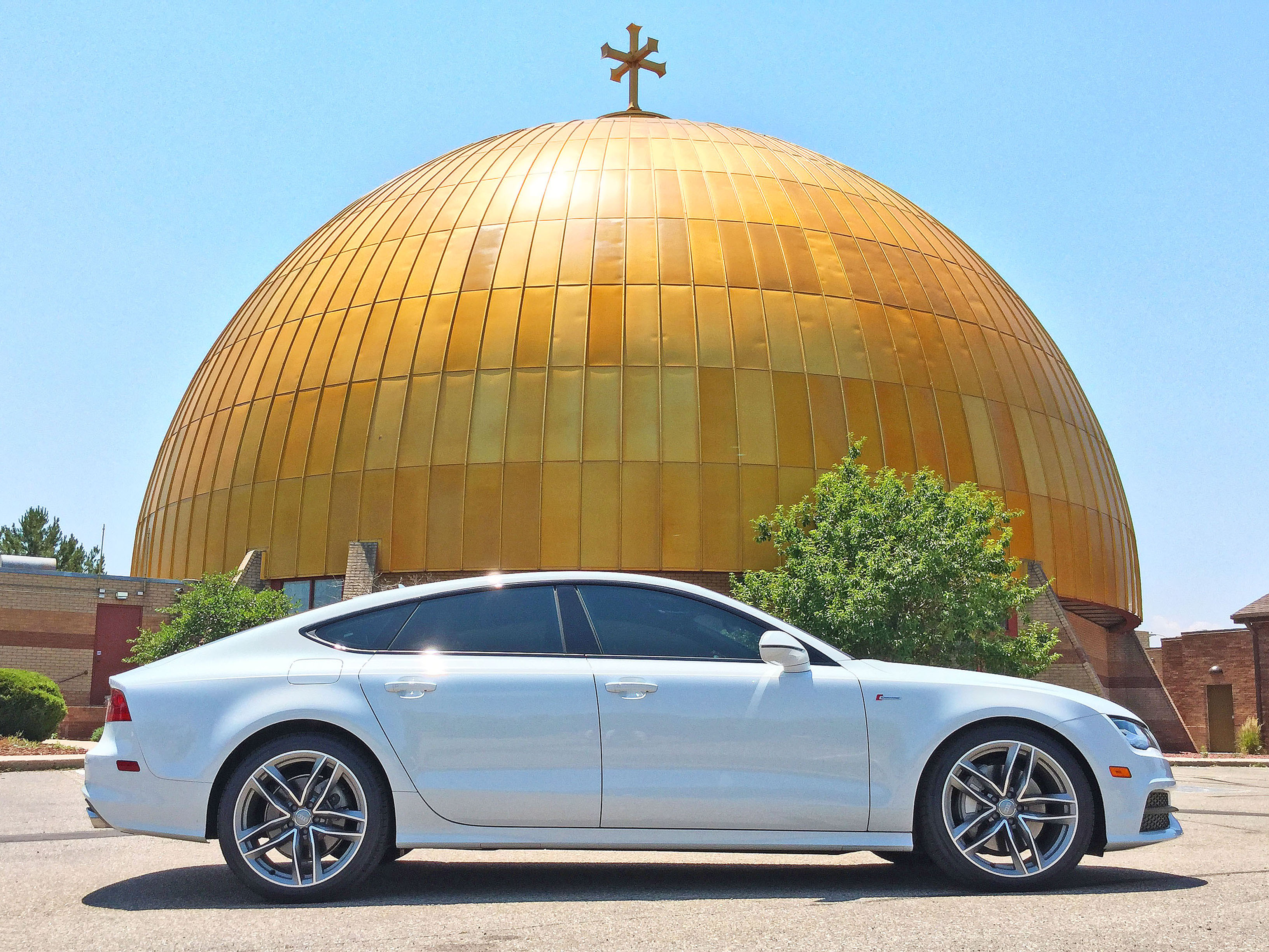 Side view of the 2016 Audi A7 parked in front of the Assumption Cathedral on the border of Denver's Hilltop neighborhood and Glendale