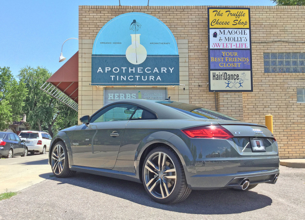 Rear view of the 2016 Audi TT parked outside of Apothecary Tinctura on 6th Avenue in Denver's Cherry Creek neighborhood