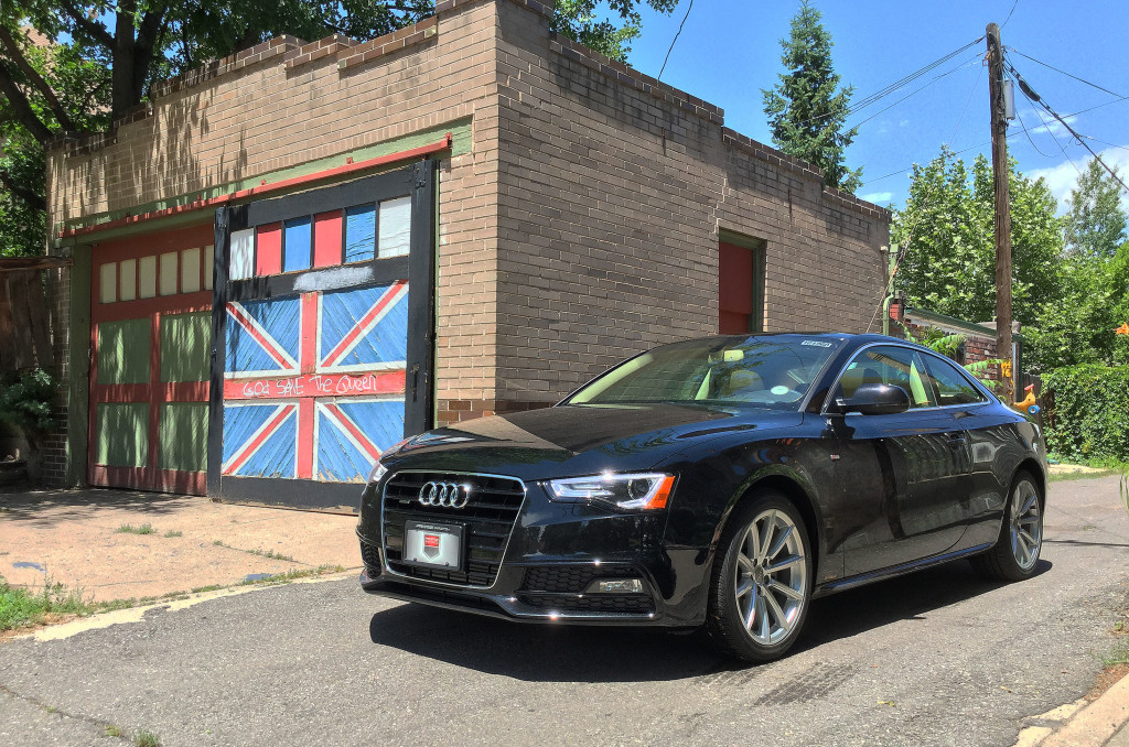 The Audi A5 parked next to a garage in Denver's Congress Park neighborhood