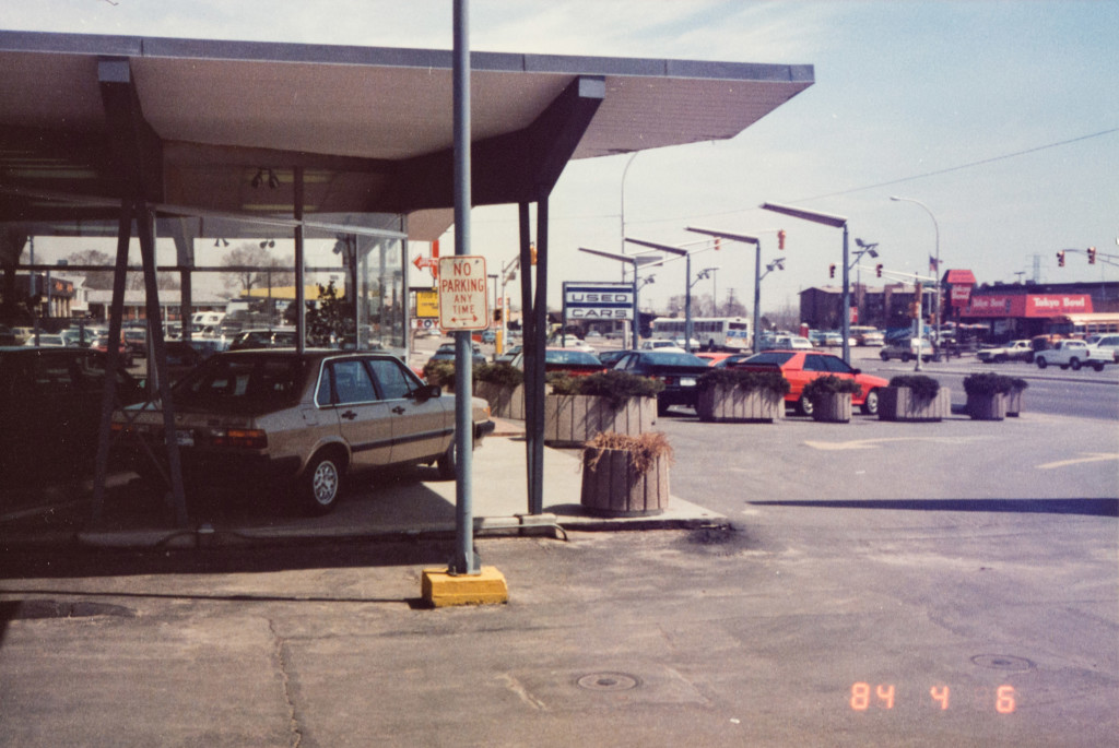 Historical Photo (1984-04-06) of the west side of Prestige Imports, a Denver Porsche and Audi Dealer