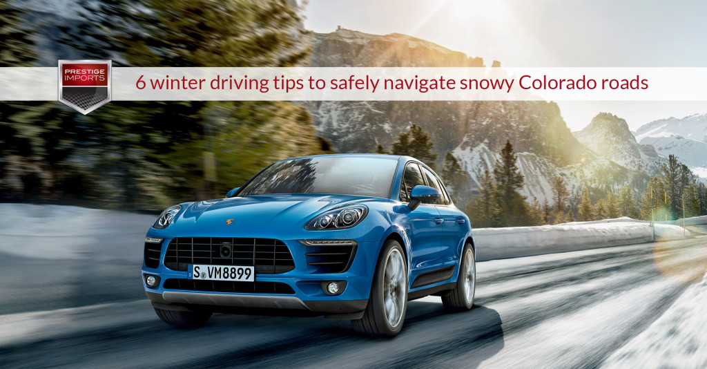 "Photo of a Porsche Macan on a snowy mountain road. Used to illustrate the article ""6 winter driving tips to safely navigate snowy Colorado roads""."
