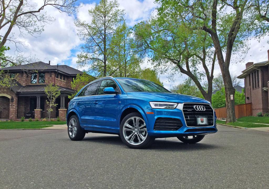 Audi Q3 in Hainan Blue metallic parked on the street in Denver's Washington Park neighborhood.