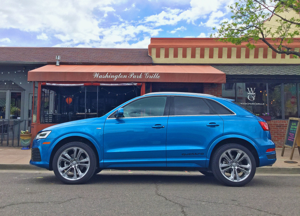 The Audi Q3 in Hainan Blue metallic parked in front of the Washington Park Grille