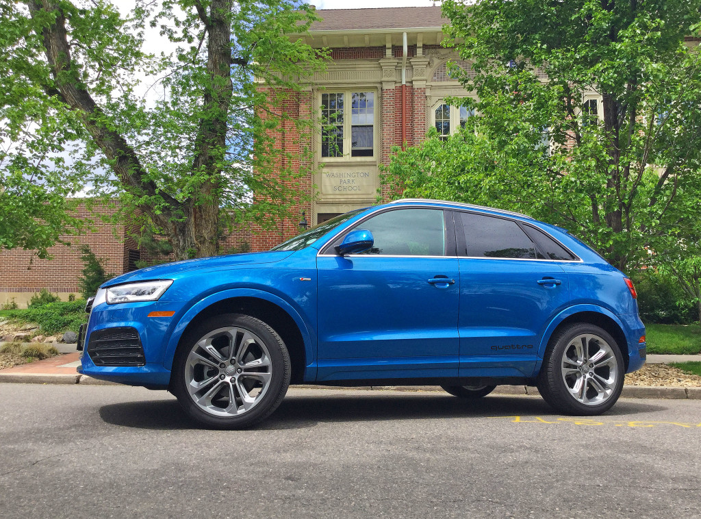 The Audi Q3 in Hainan Blue metallic photographed in front of Denver's Washington Park School