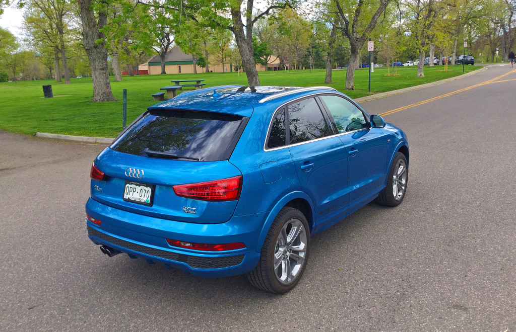 Rear view of the Audi Q3 in Hainan Blue metallic as it sits in Denver's Washington Park neighborhood