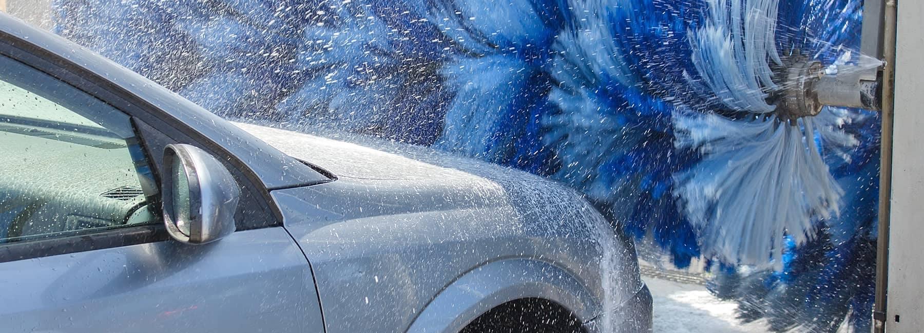 car driving through car wash