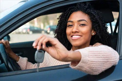 woman-in-car-holding-the-key