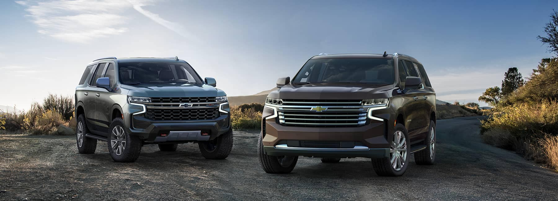 2021 Chevrolet Suburbans parked side-by-sid