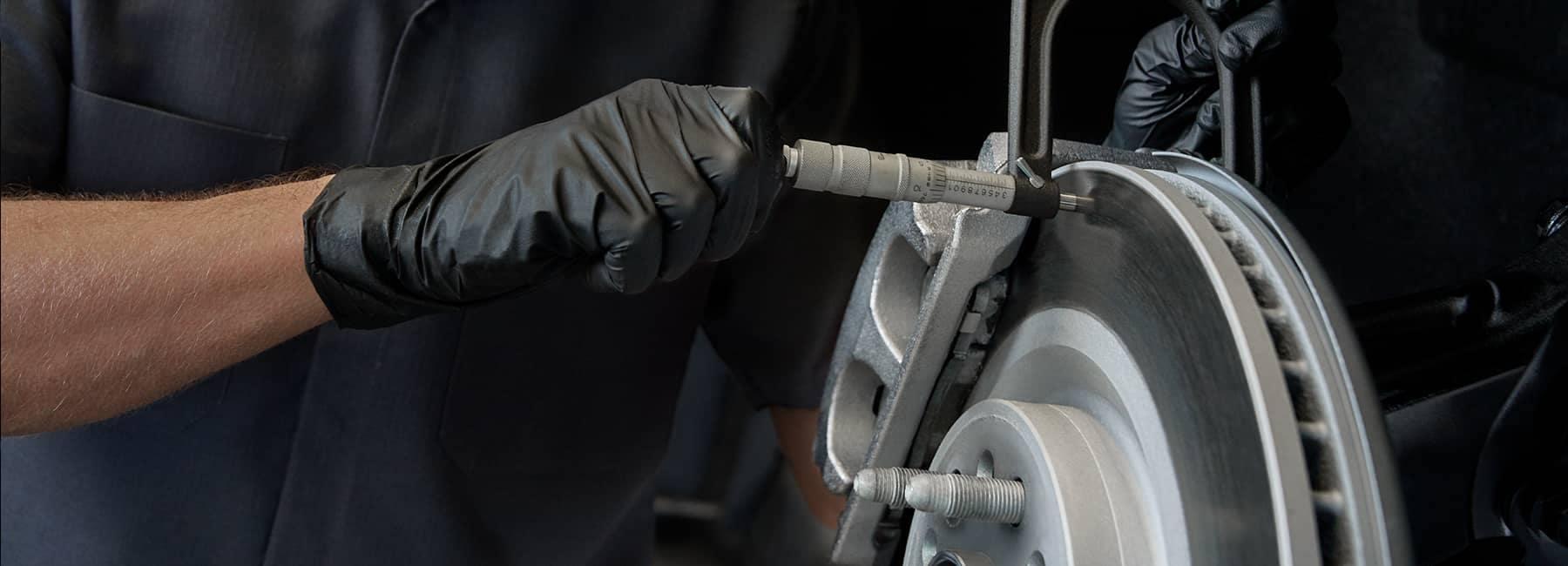 A mechanic changing brake pads