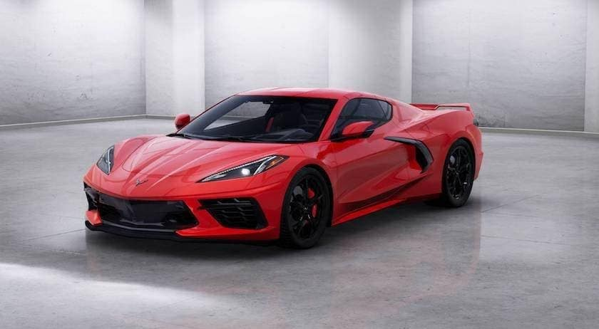 A red 2020 Chevy Corvette is in a white room.