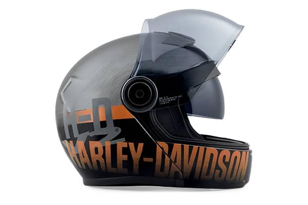 Sideview of a black Harley-Davidson motorcycle helmet with orange text on the bottom edge.