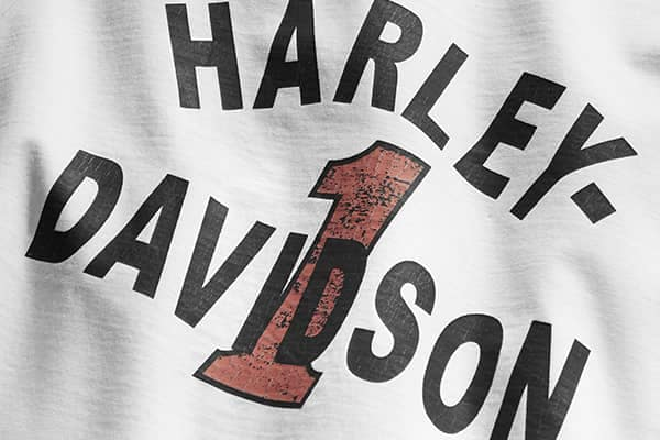 Closeup of a white Harley-Davidson T-shirt from their Performance Sportswear line.