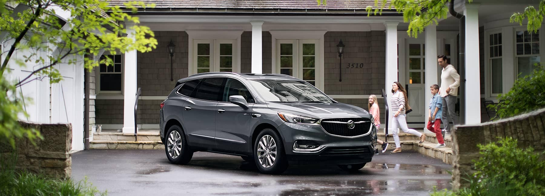 Grey 2020 Buick Enclave in Front of a House
