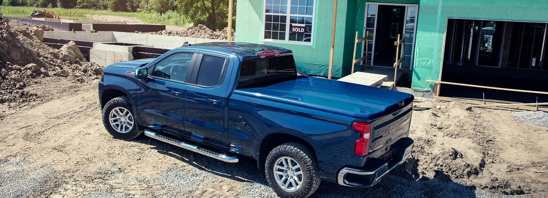 Blue 2021 Chevrolet Silverado 1500LD at a Construction Site