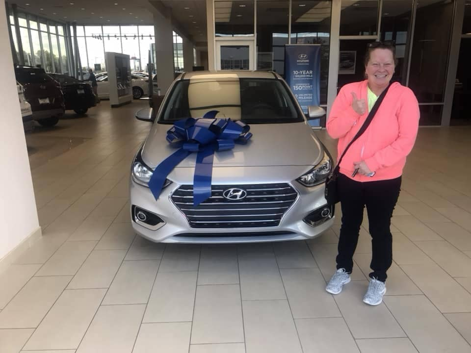 woman with her new car