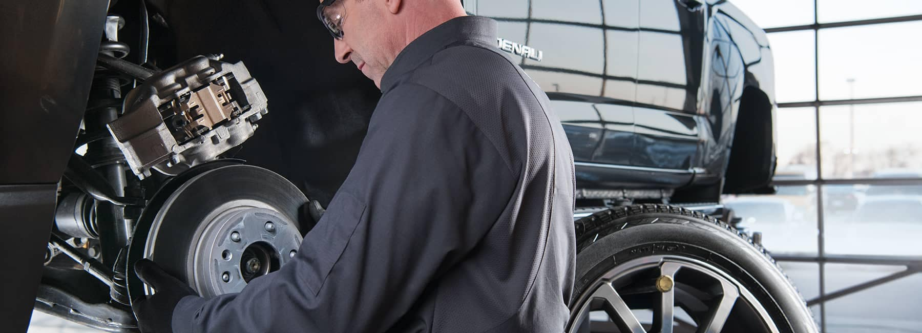 GMC Service Technician Working on Rotors and Brakes