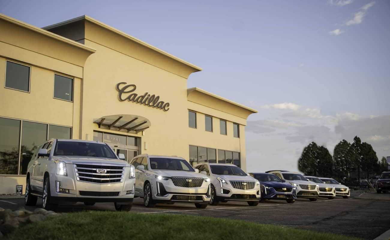 An image of the front of a Cadillac dealership.