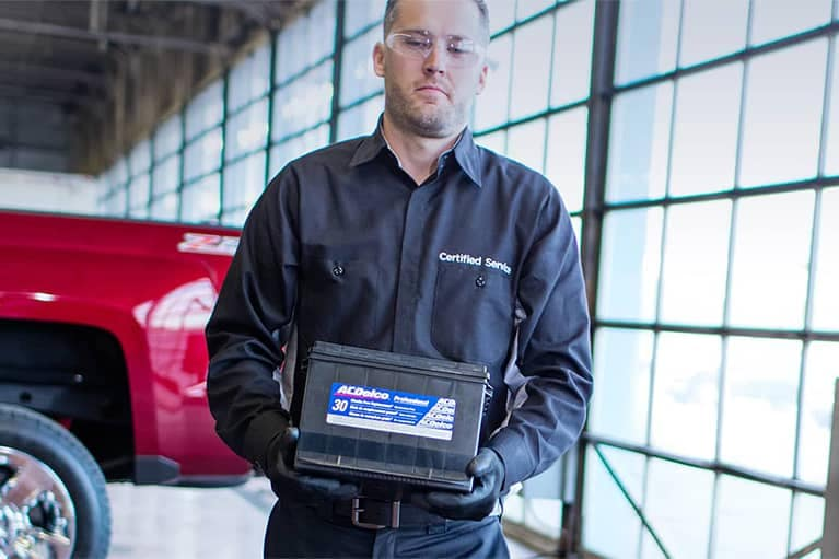 Chevrolet Certified Service Technitian Carrying ACDelco Batterty