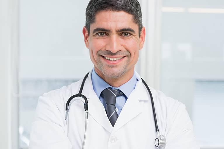 Male Doctor wearing a stethoscope