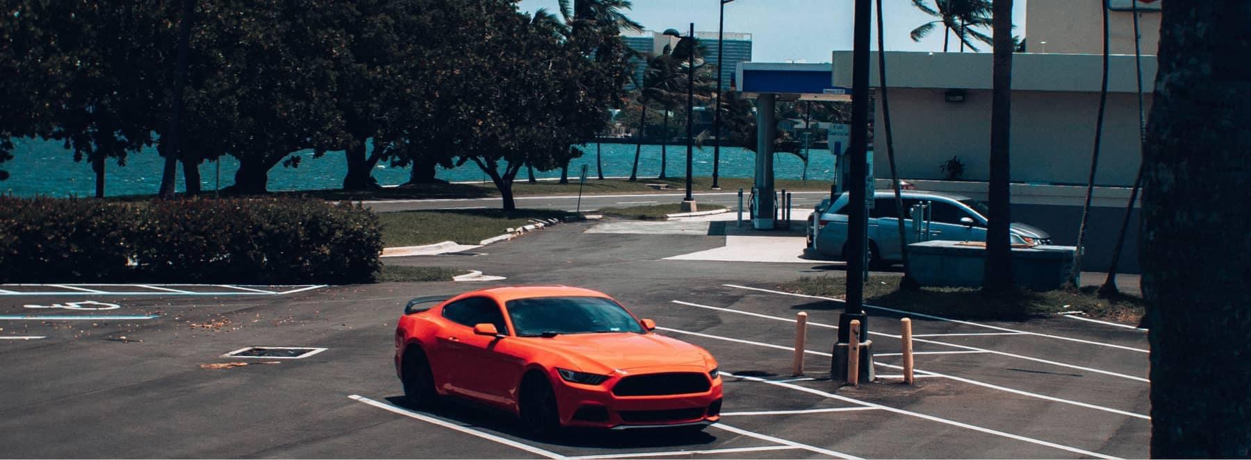 Orange Mustang in parking lot