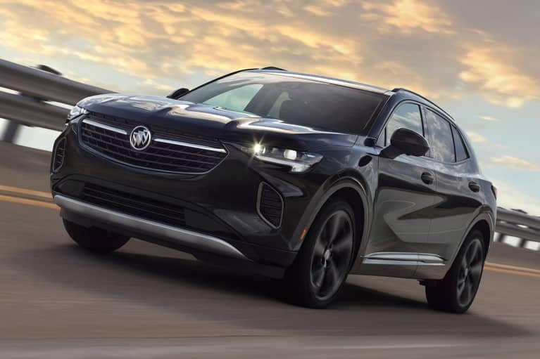 2021 Black Buick Envision speeding on the highway_mobile