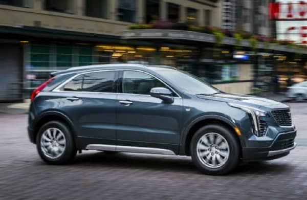 2020 Cadillac XT4 crusing smoothly over a cobblestone road