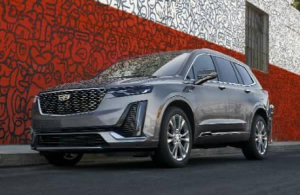 2021 Cadillac XT6 parked next to a red brick wall
