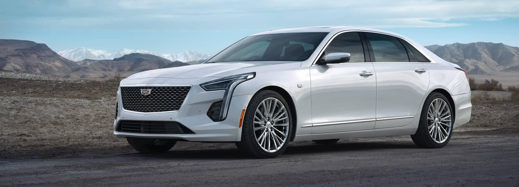 2020 Cadillac CT6 driving down road with mountains in background