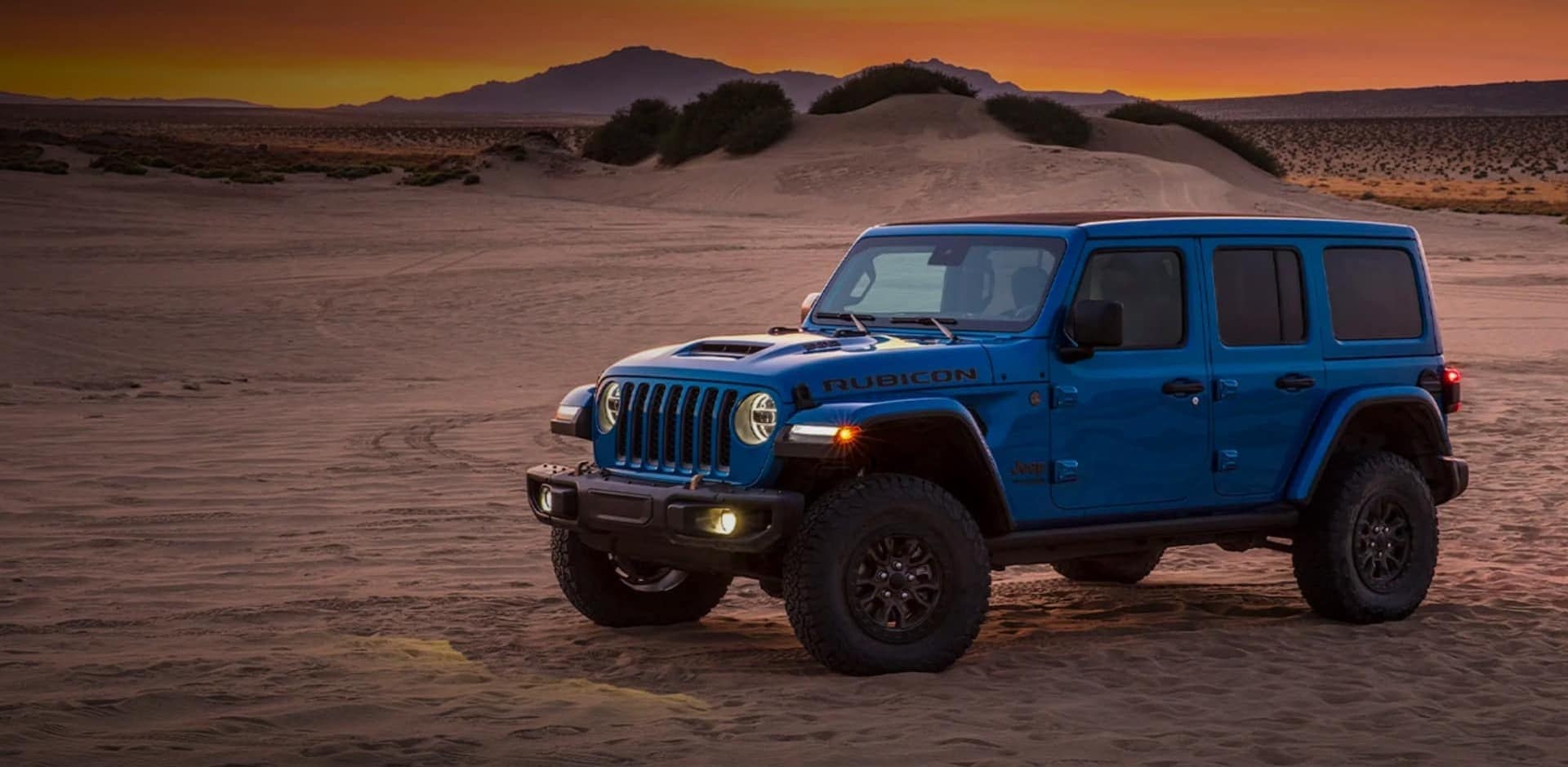 Blue Jeep in the desert