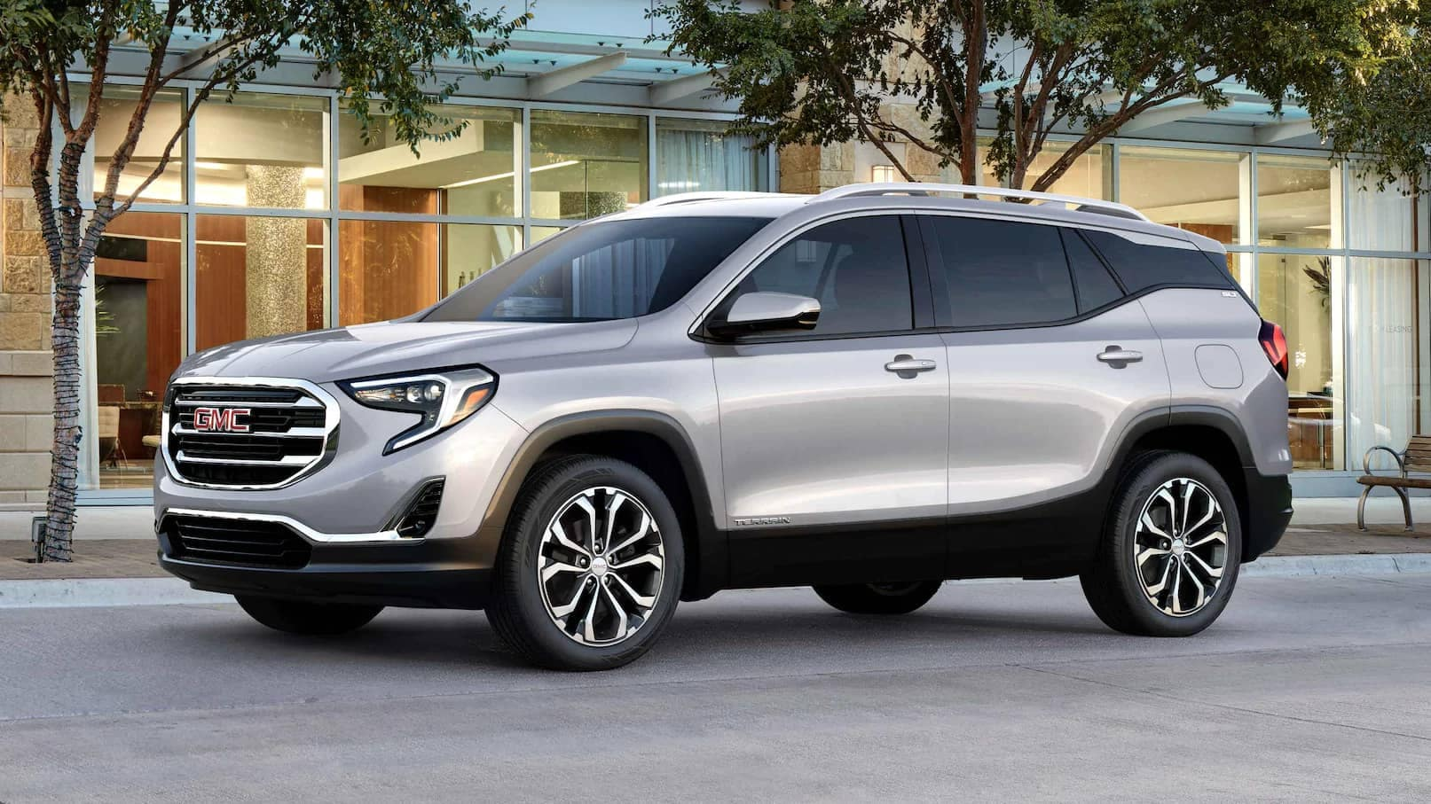 2021 GMC Terrain parked with glass building behind