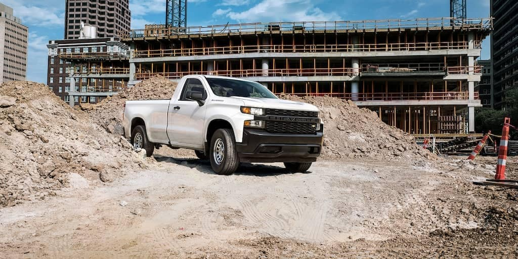 2019 Chevrolet Silverado red parked on construction site
