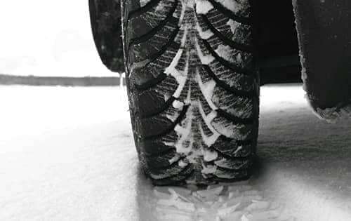 tire driving through snow