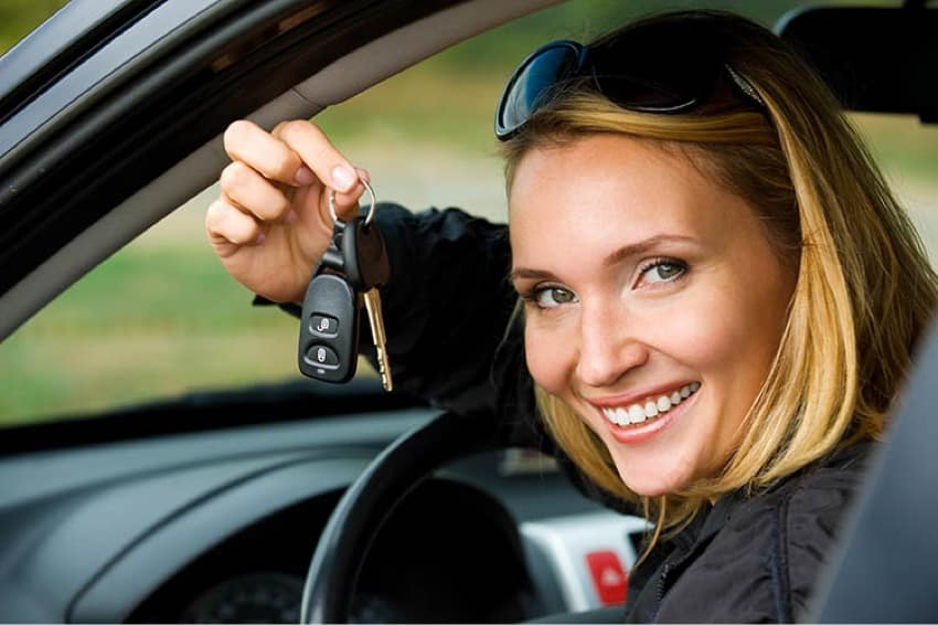 Woman holding car keys